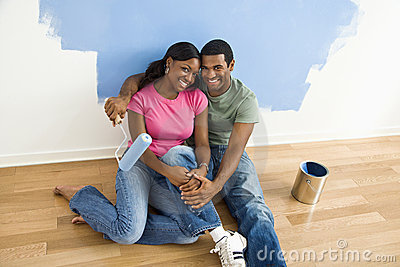 Couple relaxing while painting.