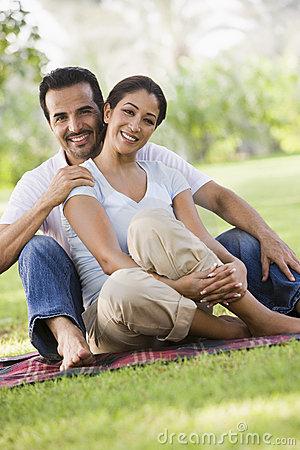 Couple relaxing in park together