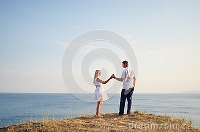 Couple relaxing at the sea