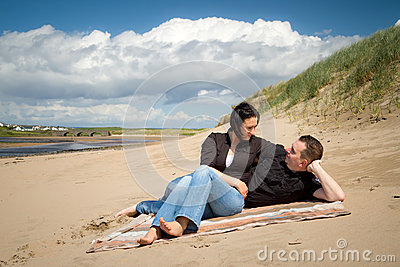 Couple relaxing on summer beach