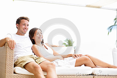 Couple relaxing together in sofa