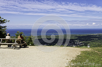 Couple relaxing at the top of Blue Mountain in central Ontario Editorial Image