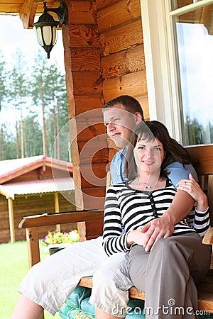 Couple relaxing on verandah