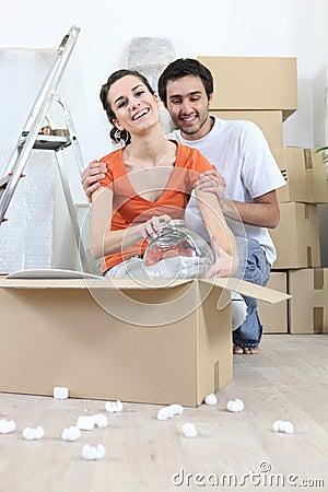Couple removing glassware
