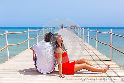 Couple resting on the pier of Red Sea