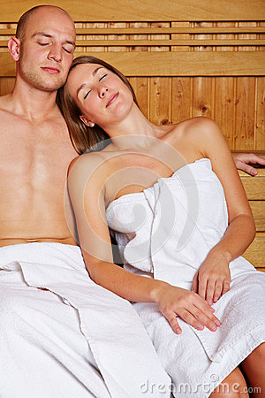 Couple resting in steam sauna