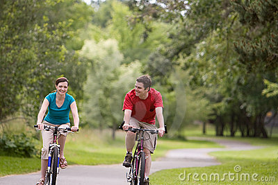 Couple Riding Bicycles at Park - horizontal