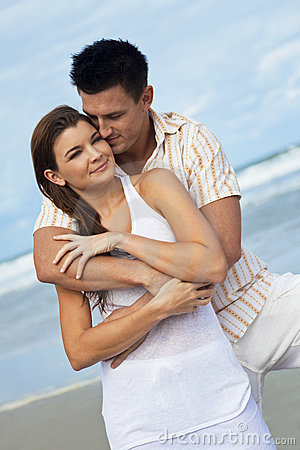 Couple In A Romantic Embrace On Beach
