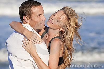 Couple In Romantic Embrace On A Beach