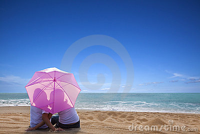 couple romantic kissing at the beach