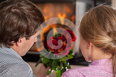 Couple, roses and fireplace