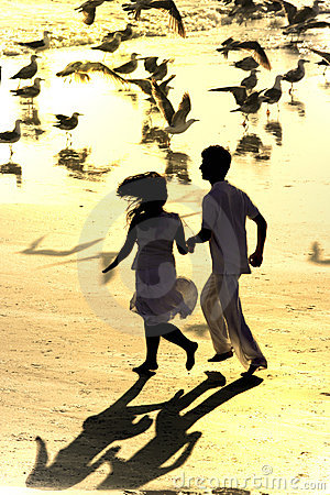 Couple running in the beach