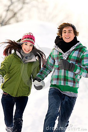 Couple running in the snow