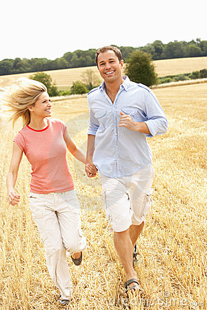 Couple Running Together Through Summer Harvested F