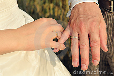 Couple s hands with wedding rings