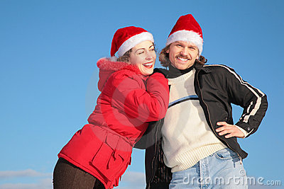 Couple in santa claus hats