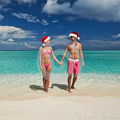 Couple in santa s hat on a beach at Maldives