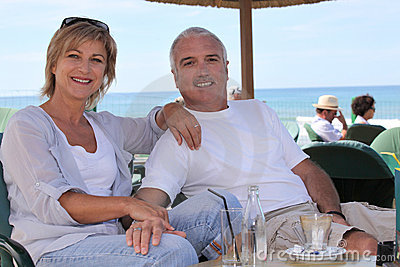 Couple sat on hotel terrace
