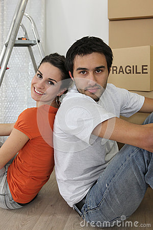 Couple sat by ladder