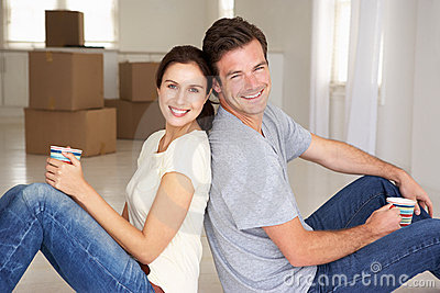 Couple sat in new home