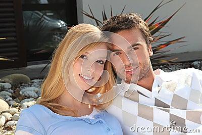 Couple sat on a terrace