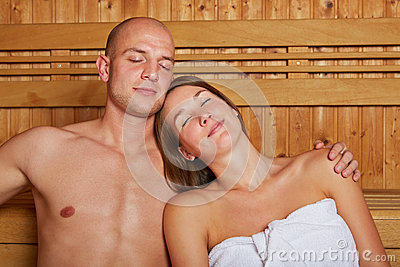 Couple in sauna with eyes closed