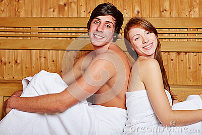 Couple in sauna leaning on each