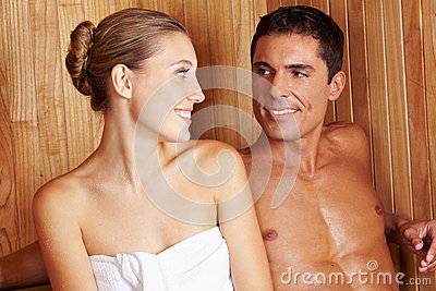Couple in sauna looking at each other