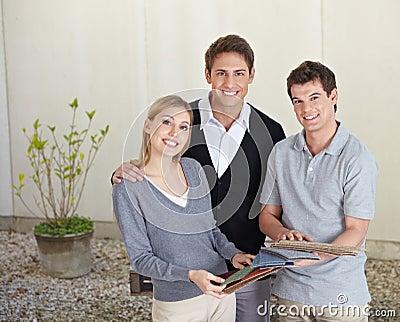Couple selecting carpet samples