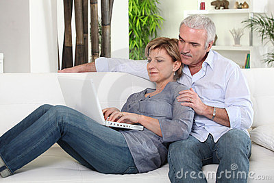 Couple sending an e-mail