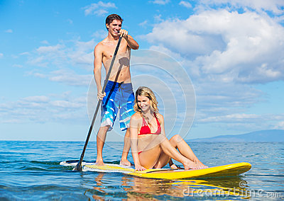 Couple Sharring Stand Up Paddle Board