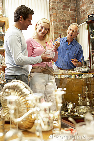 Couple shopping in antique shop