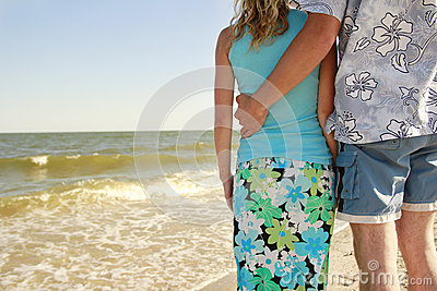 Couple  on the shore of the sea