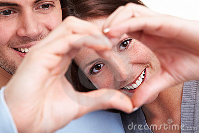Couple showing heart with fingers