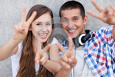 Couple showing peace sign