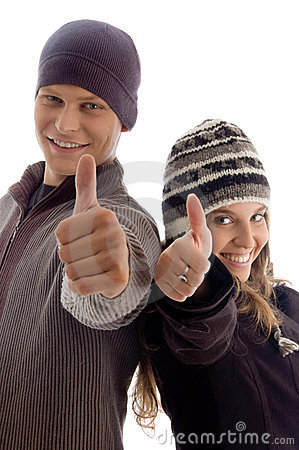 Couple showing thumbs up young
