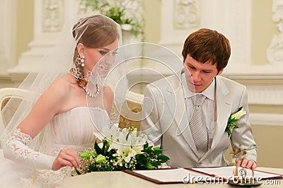 Couple Sign Wedding Register