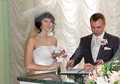 Couple signing the wedding register