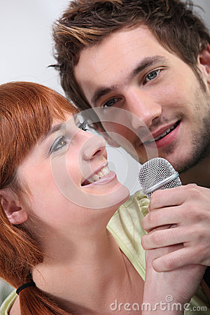 Couple singing karaoke