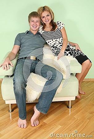 Free Couple Sit On Sofa Stock Photography - 3760042