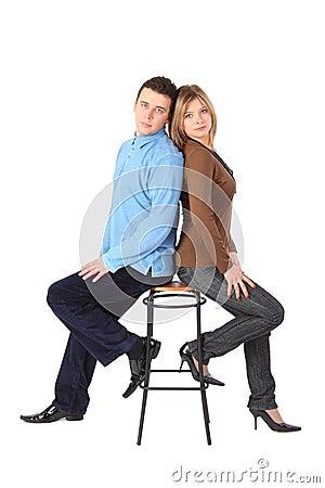Free Couple Sits On Bar Stool Back To Back Royalty Free Stock Photo - 9494245