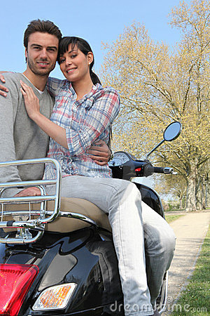 Couple sitting on a bike