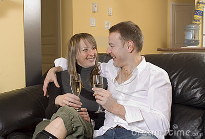 Couple sitting on black couch