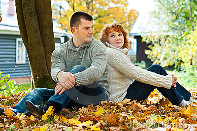 Couple sitting on ground