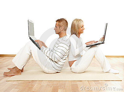 Couple sitting with laptops