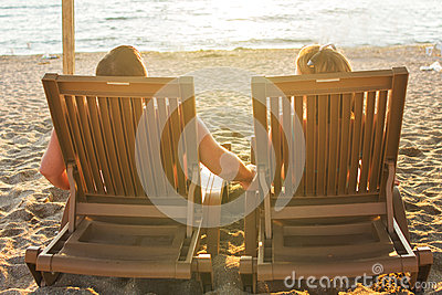 Couple Sitting On The Lounge Chairs Stock Image & Couple Sitting On The Lounge Chairs Stock Image | CartoonDealer.com ...