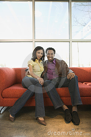 Free Couple Sitting On Couch. Royalty Free Stock Images - 2770249
