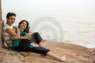 Couple sitting on the rock