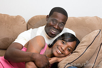 Couple Sitting on Sofa - Close-Up, Horizontal