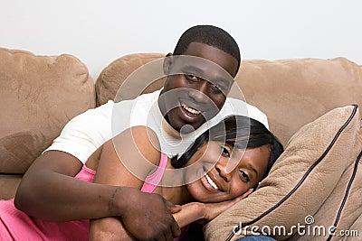 Couple Sitting on Sofa - Close-Up, Horizontal